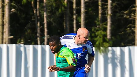 Mark Goldfinch wins this aerial challenge with Ozzy Adenije during the Ipswich Wanderers V Canvey Is