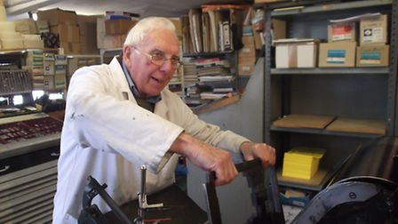 Norman Carter, 85, working at his business Norman Press in Ipswich.