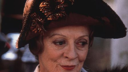 Maggie Smith who plays the dowager countess in both Gosford Park and Downton Abbey but the two Julia