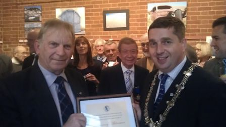 Glyn Walden, who has died aged 76, receiving his honorary alderman certificate in 2012 from then Dis