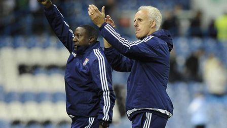 Terry Connor and Mick McCarthy are applauded off the pitch after the win at Leeds