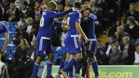 Tommy Smith is mobbed after scoring during the first half at Leeds last night