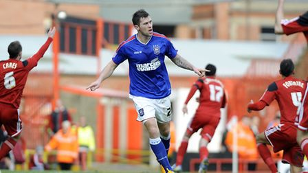 Daryl Murphy celebrates scoring Ipswich's first half goal at Bristol City whilst the defence claim o