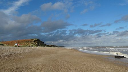 Sun, wind and water at Coastguards beach. The black lumps are enormous lumps of peat thrown up by t