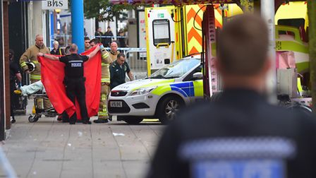 Emergency services attend the scene of a human fire on London Road North, Lowestoft.