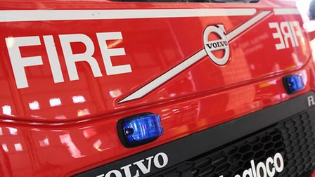Firefighters tackle a hedge fire in Stowmarket