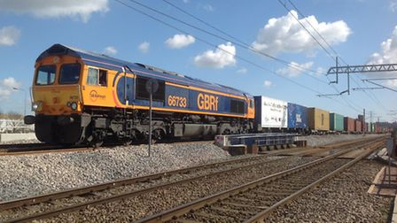 The first container train to pass over the Ipswich chord rail link in Ipswich.