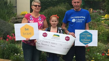 From left to right: Moira Ely, Leah Fuller and Colin Ely presenting the cheque for £2,000 to St Eliz