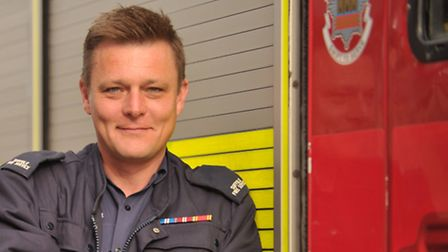 Firefighter Patrick Ince rescued a woman from her burning flat during the Sudbury fire.