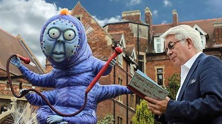 The Principal of Homerton, Professor Geoff Ward, reads Alice in Wonderland to Cuthbert the Caterpill