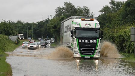Traffic chaos caused by flooding on the A143 near Bury St Edmunds.