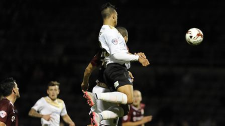 Macauley Bonne scores with a header during the first half at Northampton tonight