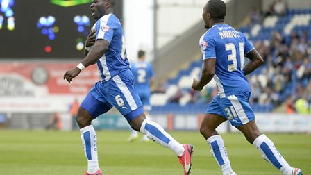 Pround to wear the shirt: George Elokobi celebrates after equalising with a late header against Scun