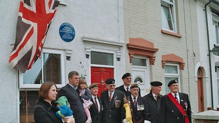 Relatives of Arthur Saunders and war veterans celebrate the unveiling of a plaque in his honour