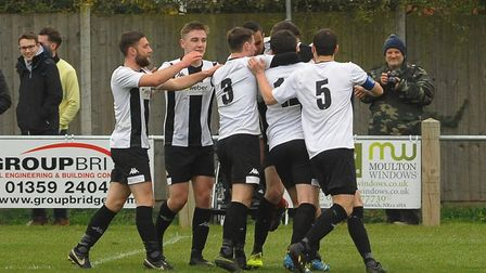 Harleston celebrate Lawrence Cheese's goal against Diss, which turned out to be the winner Picture: