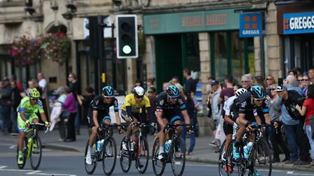 Team Sky's Ben Swift (right), Ian Stannard (centre) and Wout Poels (second left) ride through Matloc