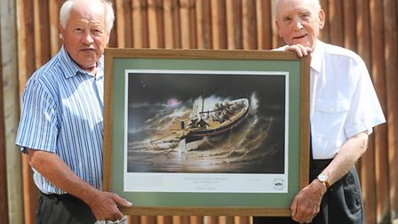 Derek George, left, from Caister Volunteer Lifeboat Service, presents Don Hill with a picture of a l