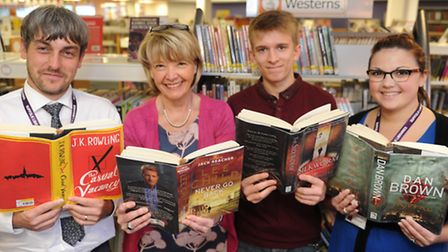 Staff and volunteers at Ipswich Library with some of the top ten books in Suffolk Matt Shenton, Mar