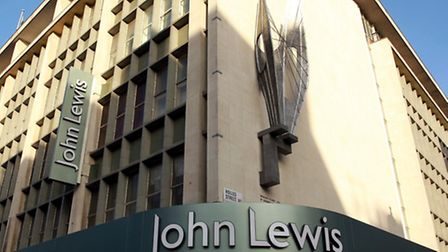 The John Lewis Partnership has posted a 26% slide in half-year profits.