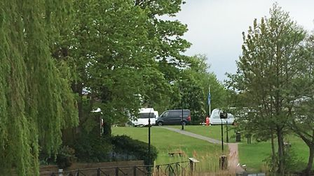 Travellers caravans on Diss Park seen from the Mere. Picture: Simon Parkin