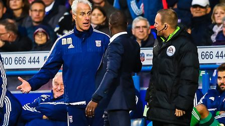 Mick McCarthy gets animated on the touchline with Huddersfield manager Chris Powell during the Ipswi
