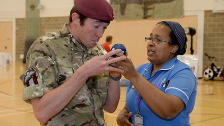 Major Nick Burdick from 16 Air Assault Brigade Headquarters, tests out his carbon dioxide levels.