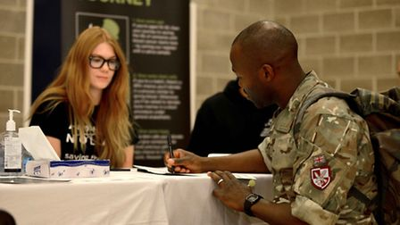 Sergeant Regis Nhara, from 16 Medical Regiment, signs onto the Anthony Nolan Trust, whilst Katie Chr