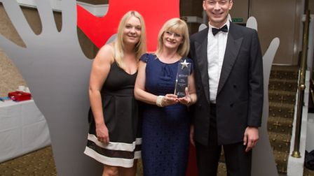 Angela Weigh and Christian Bone of the East of England Co-op receiving the society's trophy at the U