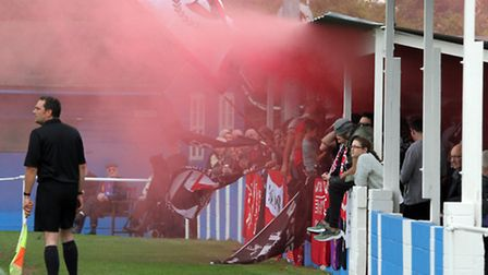 Ipswich Wanderers (blue shirts) V Clapton United iin the FA Vase. Clapton fans let off a smoke bomb