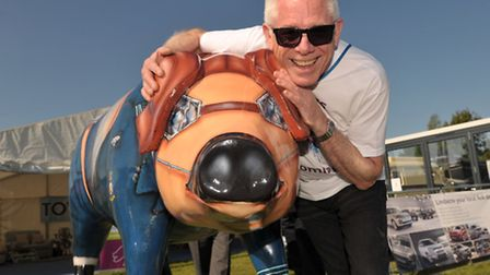 Pigs Gone Wild campaign project leader Norman Lloyd with the organisation's own pig sculpture.