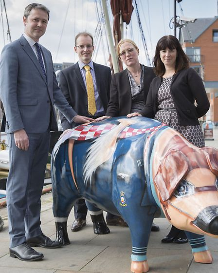 Team members from law firm Ashton KCJ showing their support for the Pigs Gone Wild public art initia