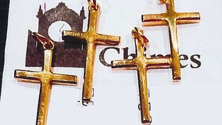 Gold cross pendants stolen in burglary in Inglis Road, Colchester, made from the wedding rings of th