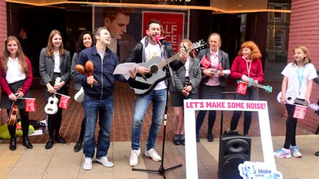 Heart FM DJ Dave Taylor during the charity busking session on the Cornhill in Ipswich where he was a