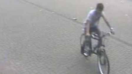 One of the CCTV images police have issued in their search for a teenager who stole a bicycle from Gr