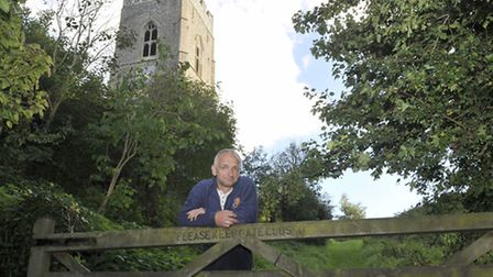 Andy Hazell is against adding steps into a green path next to the church in Kersey.