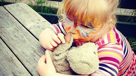 Hattie Lewis holding 'Mr Ted' He went missing on Wednesday, September 30