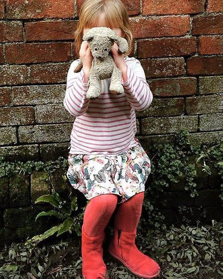 Hattie Lewis holding 'Mr Ted' He went missing shortly on Wednesday, September 30