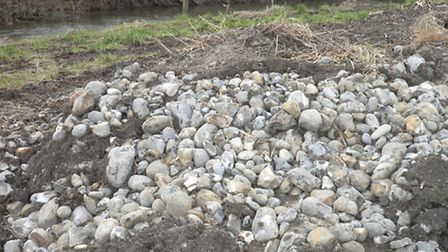 An example of serious damage done to a watercourse, with the removal of hard river bed material that
