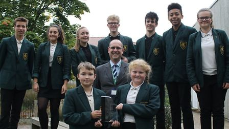 Mr Bacon with students at Thurstable School