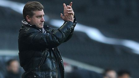 Ipswich Town will take on Karl Robinson's side on Sky Sports on December 12