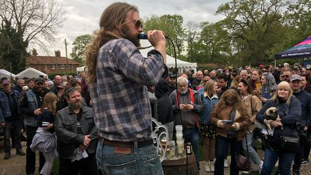 Auctioneer Adam Stokes takes bids at the Beers, Bikes and Bands charity auction at the Burston Crown