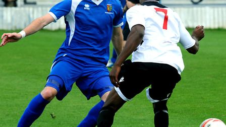 Ollie Canfer (blue) in action for Ipswich Wanderers at the start of last season
