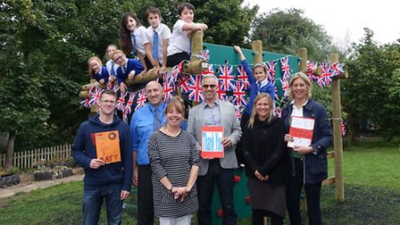 Staff and pupils at Bramfield Primary School at its new play equipment after fundraising at The Big