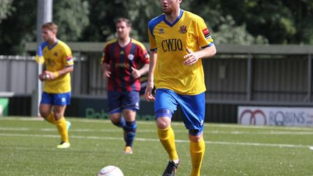 Bury's Ollie Canfer in action for AFC Sudbury