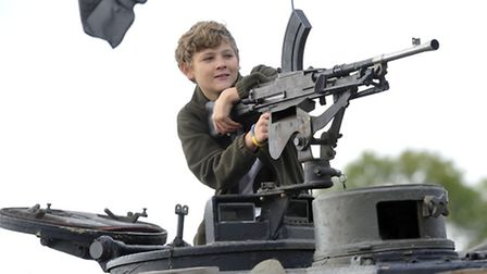 Mitchell Simpson, 12, sits behind the gun on a Abbot Self-propelled gun at a military remembrance fe