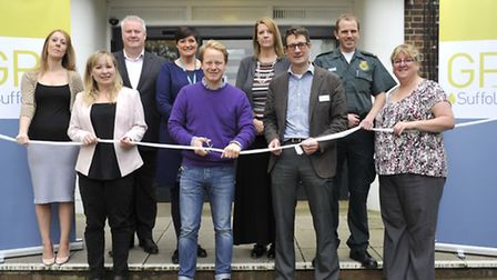 """Ben Gummer MP cuts the """"bandage"""" to officially open GP Plus at the Riverside Clinic with members of"""