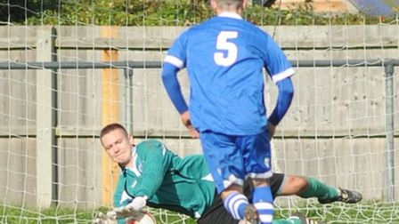 Haverhill Borough's Charlie Turner saves a penalty, but it wasn't enough to stop his side from slipp