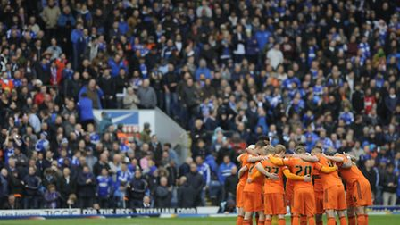 The town players have their usual huddle before kick-off at Blackburn last season