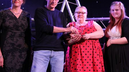 Gainsborough Community Library are presented with the Team of the Year award by Deborah Cadman of Su