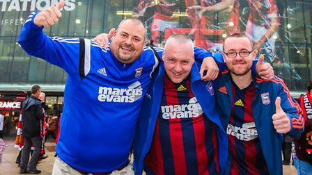 Town fans outside Old Trafford (from left): Craig Hamilton, Kev Dauven and Jake Hamilton.Picture: